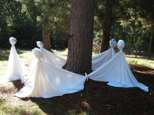 I pass these ghosts almost every day!  My fav. Halloween decoration yet!